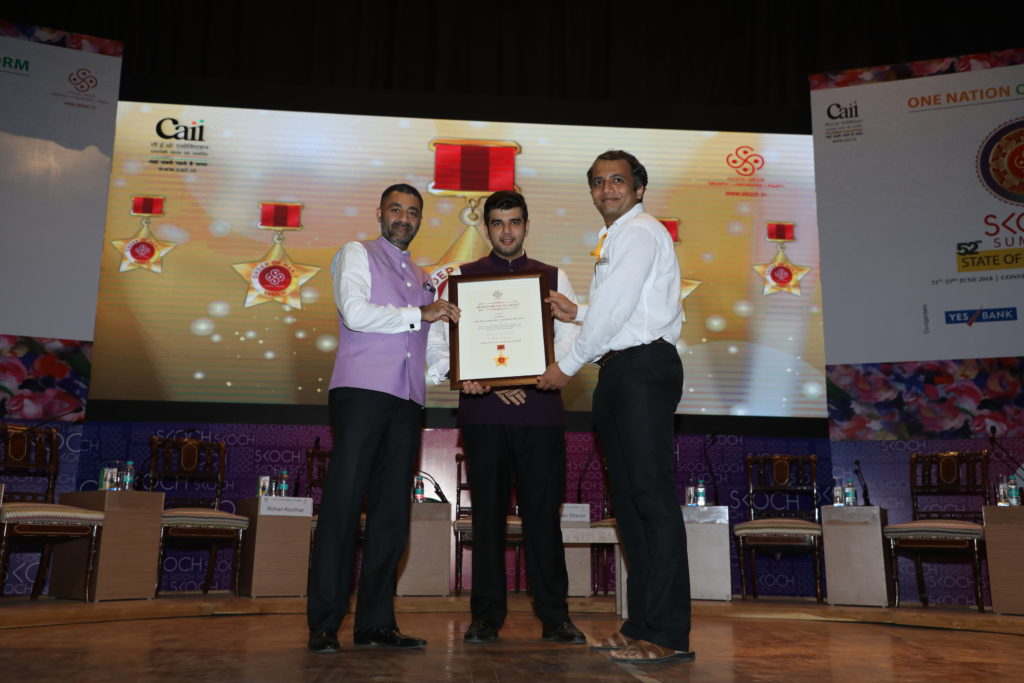 Mr. Rigved Shenai accepting the award from Skoch Group MD.